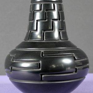 DR 280 Cliff Roller Carved Black Ware Jar